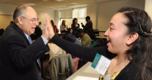 Will Schlossenberg high-five's a student at the Scholarship and Donor Recognition Luncheon.